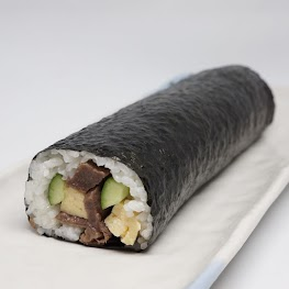 """What is """"Eho-Maki""""? On February 3rd, people in Japan celebrate Setsubun, the coming of spring with eating a good fortune sushi roll called """"Eho-Maki"""".   How to eat """"Eho-Maki""""? The proper way to eat this is to face a certain direction, this year it is West-South-West, and eat the entire sushi roll without stopping. Usually, sushi rolls are sliced into bite-sized pieces. But fortune rolls aren't sliced since slicing indicates cutting good fortune."""