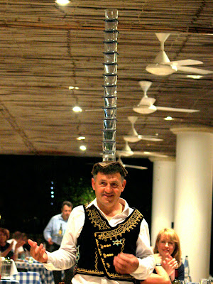 Man Balancing Glasses on His Head in Cyprus