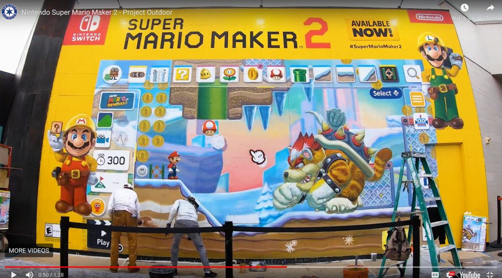 billboard painting on wall by Nintendo Switch, promoting Super Mario Maker 2