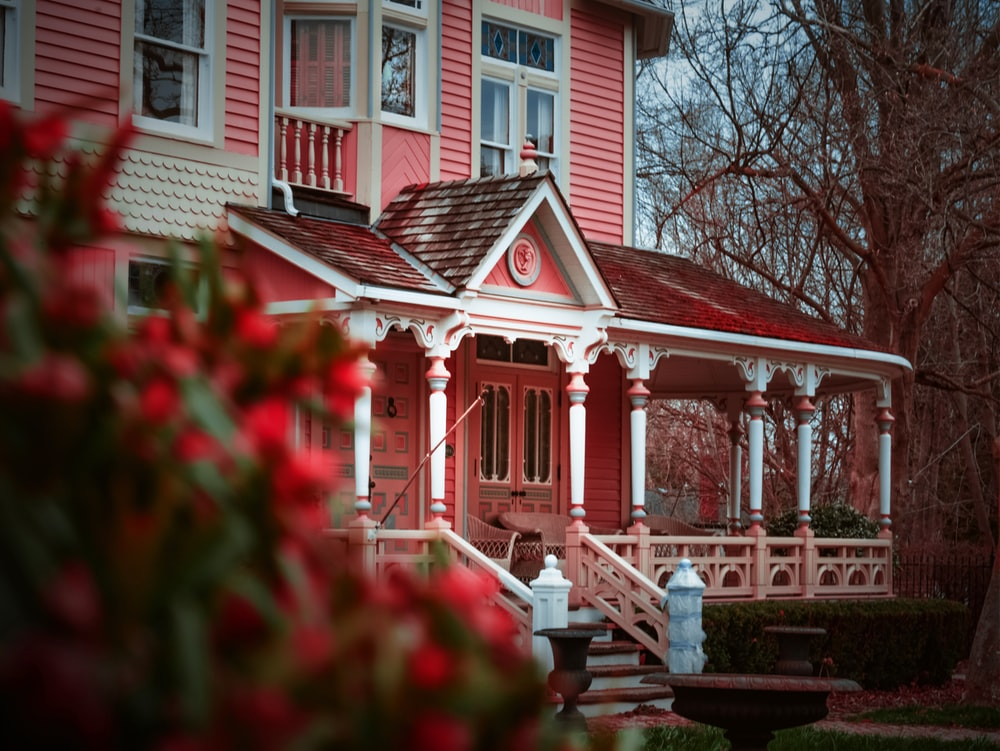 selective focus photography of red and white wooden house during daytime
