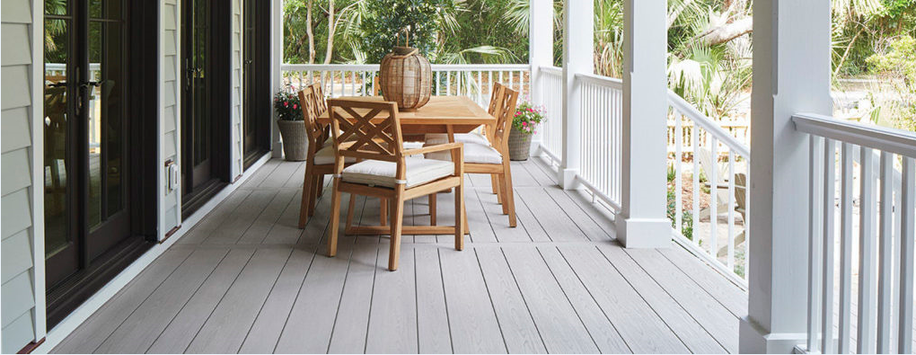wrap around porch with table and chairs