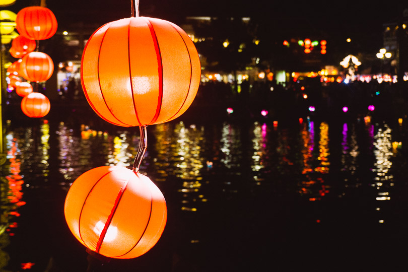Lanterns reflecting on a river.