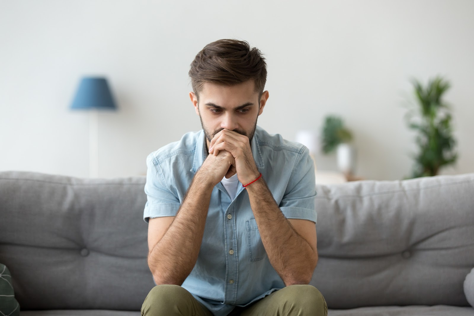 Man looking indecisive, stressed