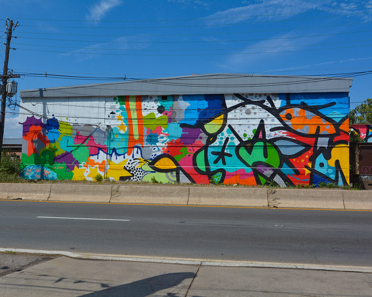 """Inside Look at Jersey City's Burgeoning Street Art. """"To JC, With Love,"""" collaboration by John CRASH Matos and JM Rizzi. 725 Tonnelle Ave. Photo by Canvs, used with permission from Jersey City Mural Arts Program."""