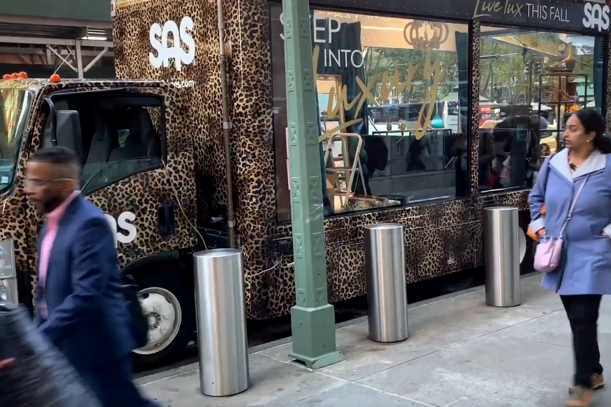 San Antonio Shoes leopard print truck-side ad with window showing a shoe store inside the truck.