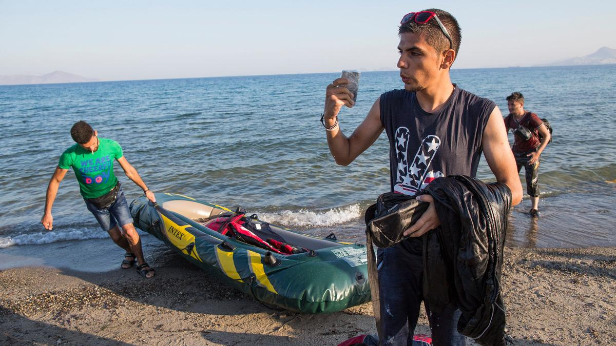 Refugees Smartphone Shore