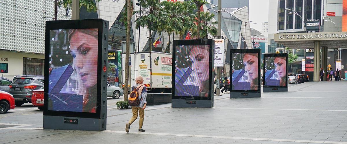 Multiple digital billboards lining up on the paveway