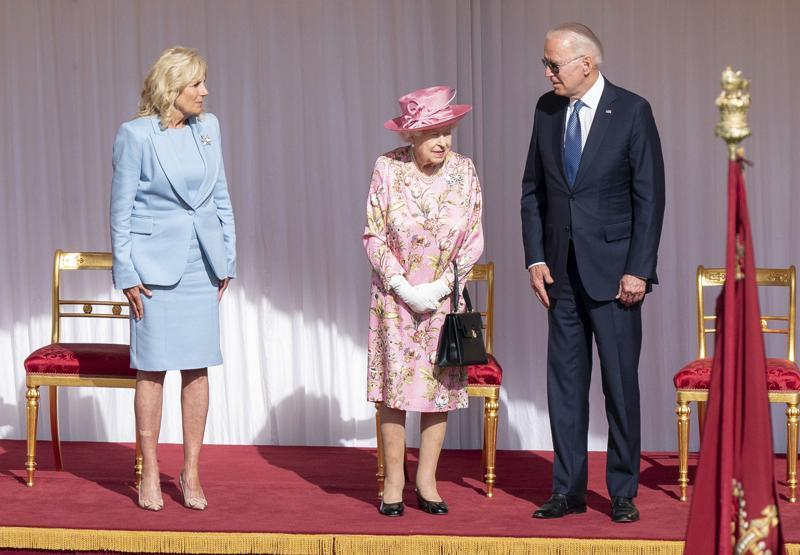 US President Joe Biden and First Lady Jill Biden with Britain's Queen Elizabeth II during a visit to Windsor Castle, in Windsor, England, Sunday June 13, 2021. The queen hosted President Joe Biden and First Lady Jill Biden at Windsor Castle, her royal residence near London. Biden flew to London after wrapping up his participation in a three-day summit of leaders of the world's wealthy democracies in Cornwall, in southwestern England. (Arthur Edwards/Pool via AP)