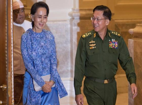 Suu Kyi with Senior General Min Aung Hlaing, right, in this March 30, 2016 photo [Ye Aung Thu/AFP]