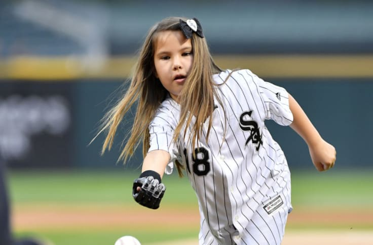 Hailey at age 8 tossing the first pitch
