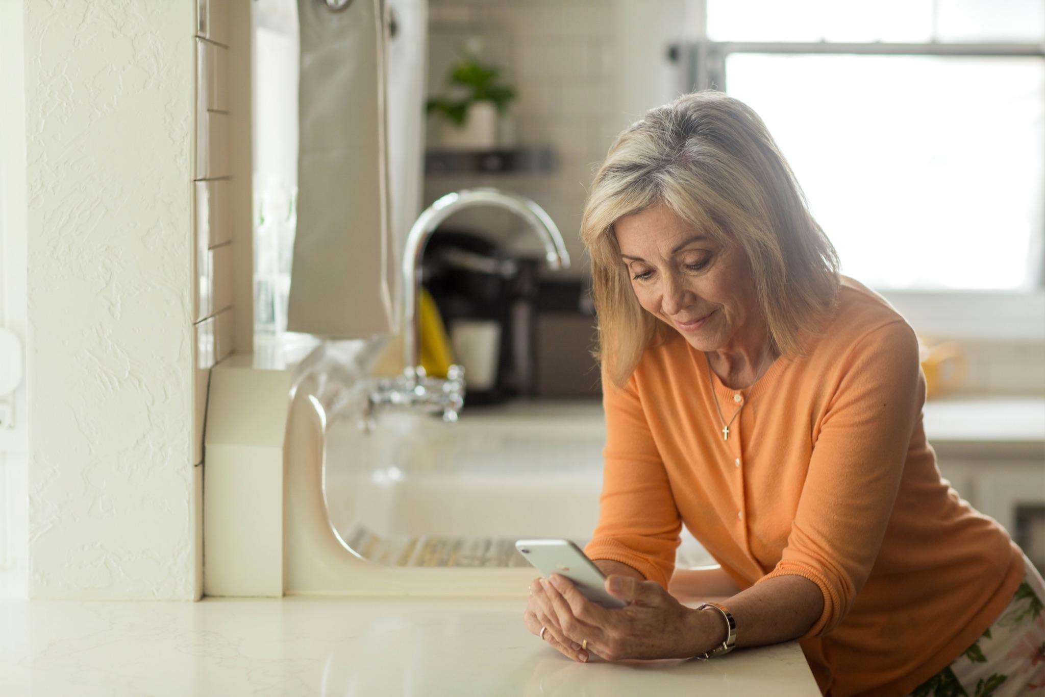 Elderly woman using a phone