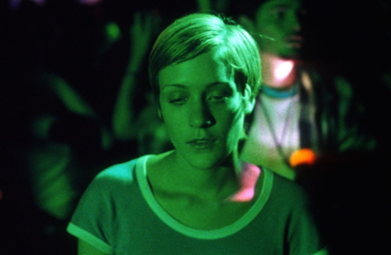 Jennie at a club drugged up and bathed in green light in Larry Clark's Kids