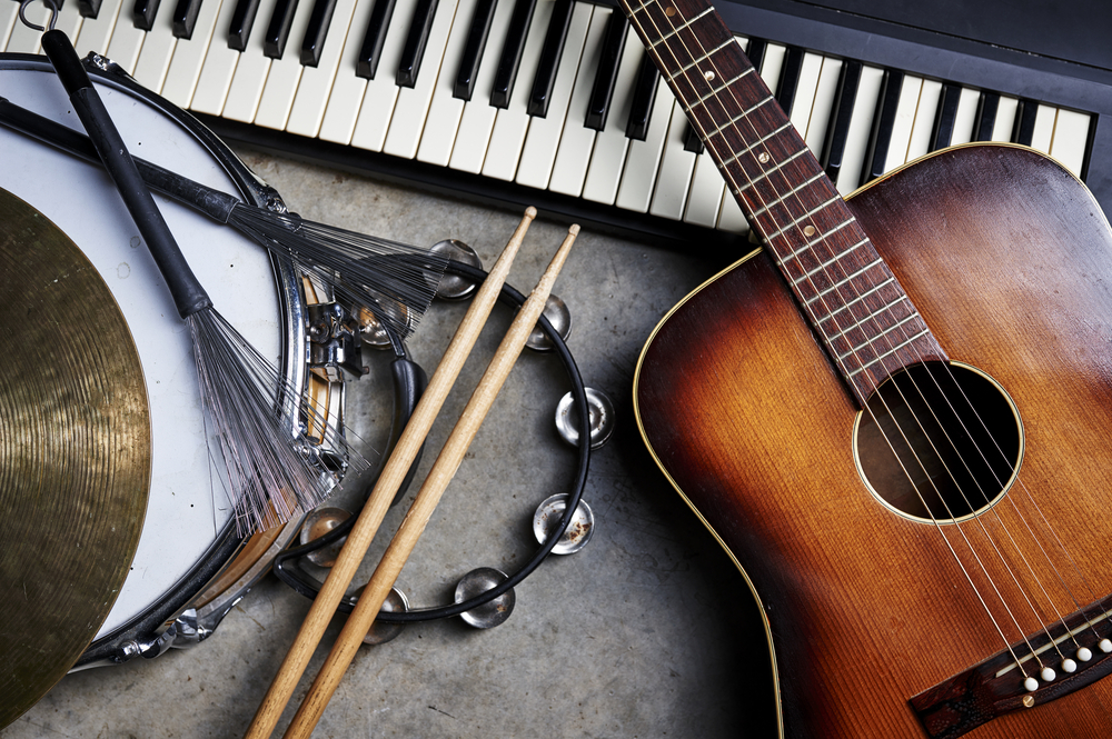 Variety of musical instruments, including acoustic guitar, keyboard, and drum.