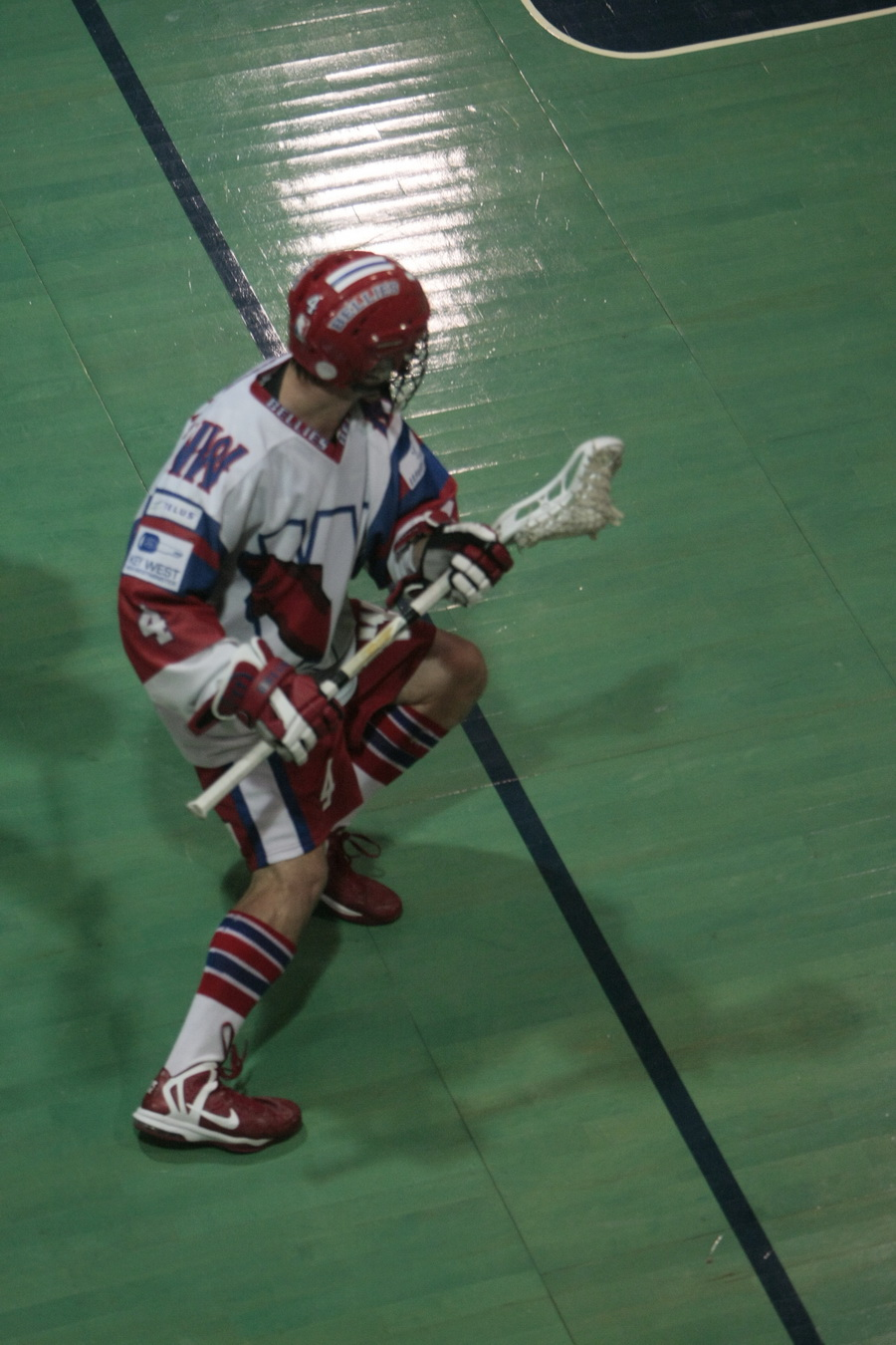Chet Koneczny pro lacrosse player performing a roll dodge