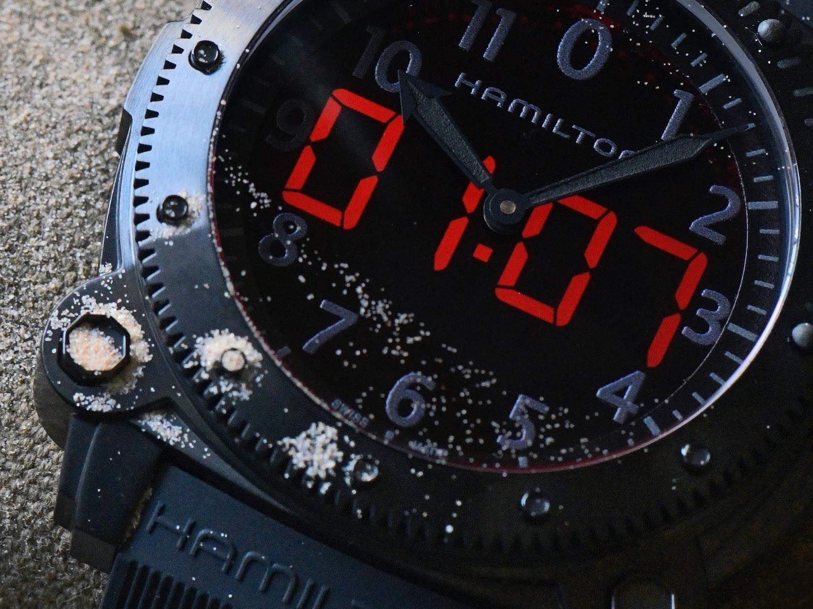 A picture containing text, black, watch  Description automatically generated