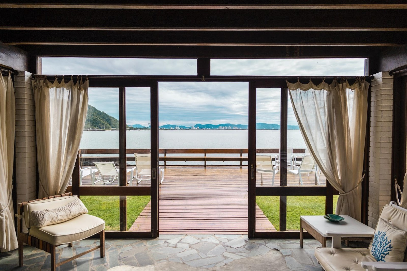 An open door and a waterfront view