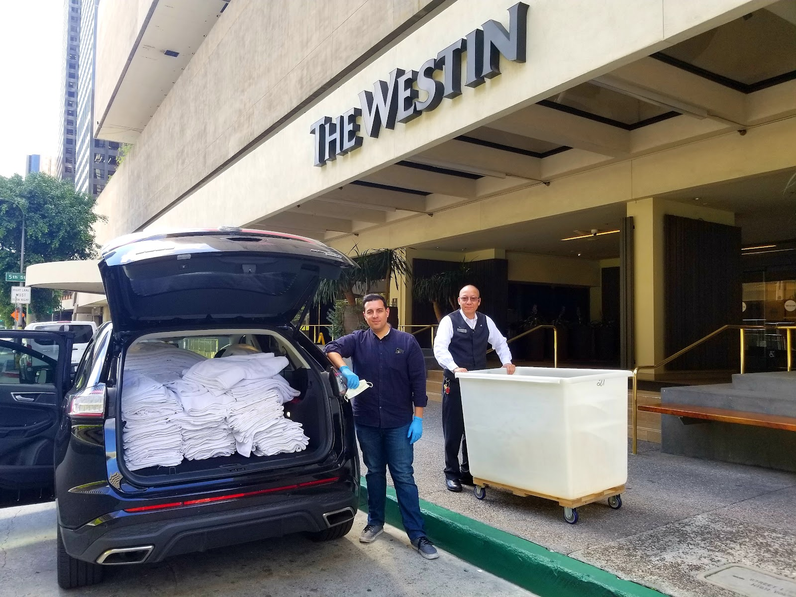 Man with car full of towels