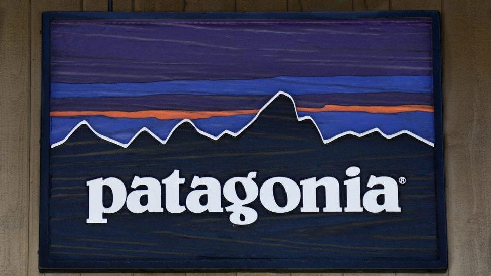 VAIL, CO - JUNE 9, 2017: A sign hangs over the entrance to the Patagonia outdoor clothing shop in Vail, Colorado. The retail chain is based in Ventura, California.