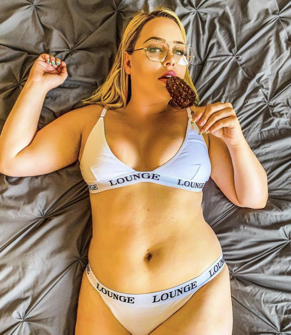 Alex Karpovek in underwear eating an ice cream