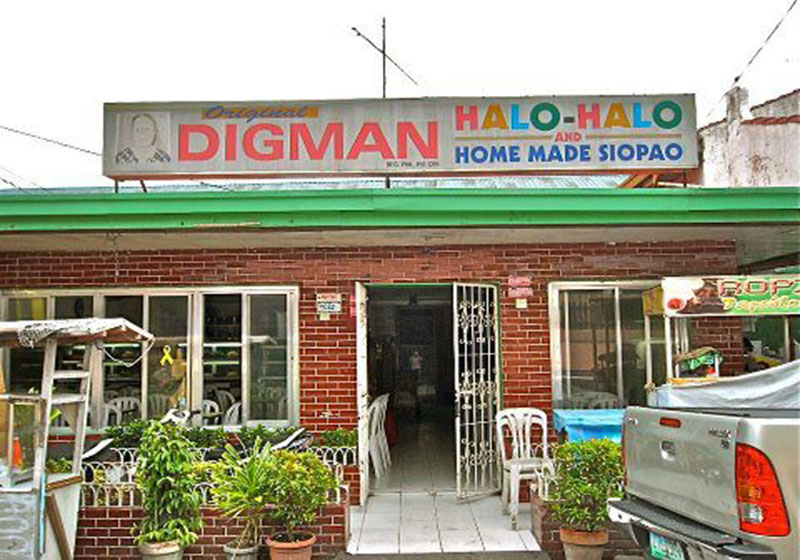 small establishment with brick wall entrance and signage text Digman