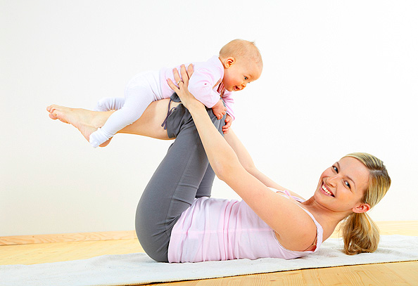 New Mom practicing Yoga after childbirth to reduce baby fat.
