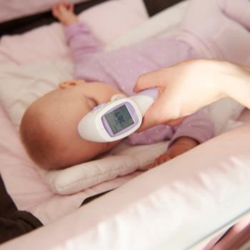 baby temperature being taken