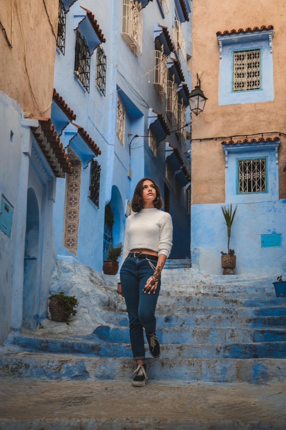 woman-in-white-long-sleeved-shirt-walking-down-stairs-in-2438056.jpg