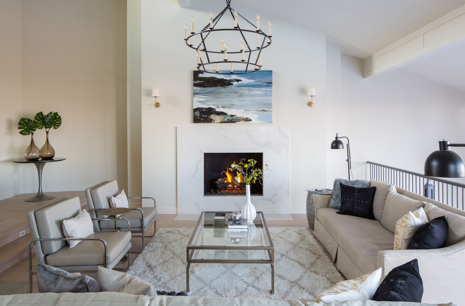 NW Calgary modern traditional living room, caesarstone quartz fireplace, soft patterned rug, chandelier