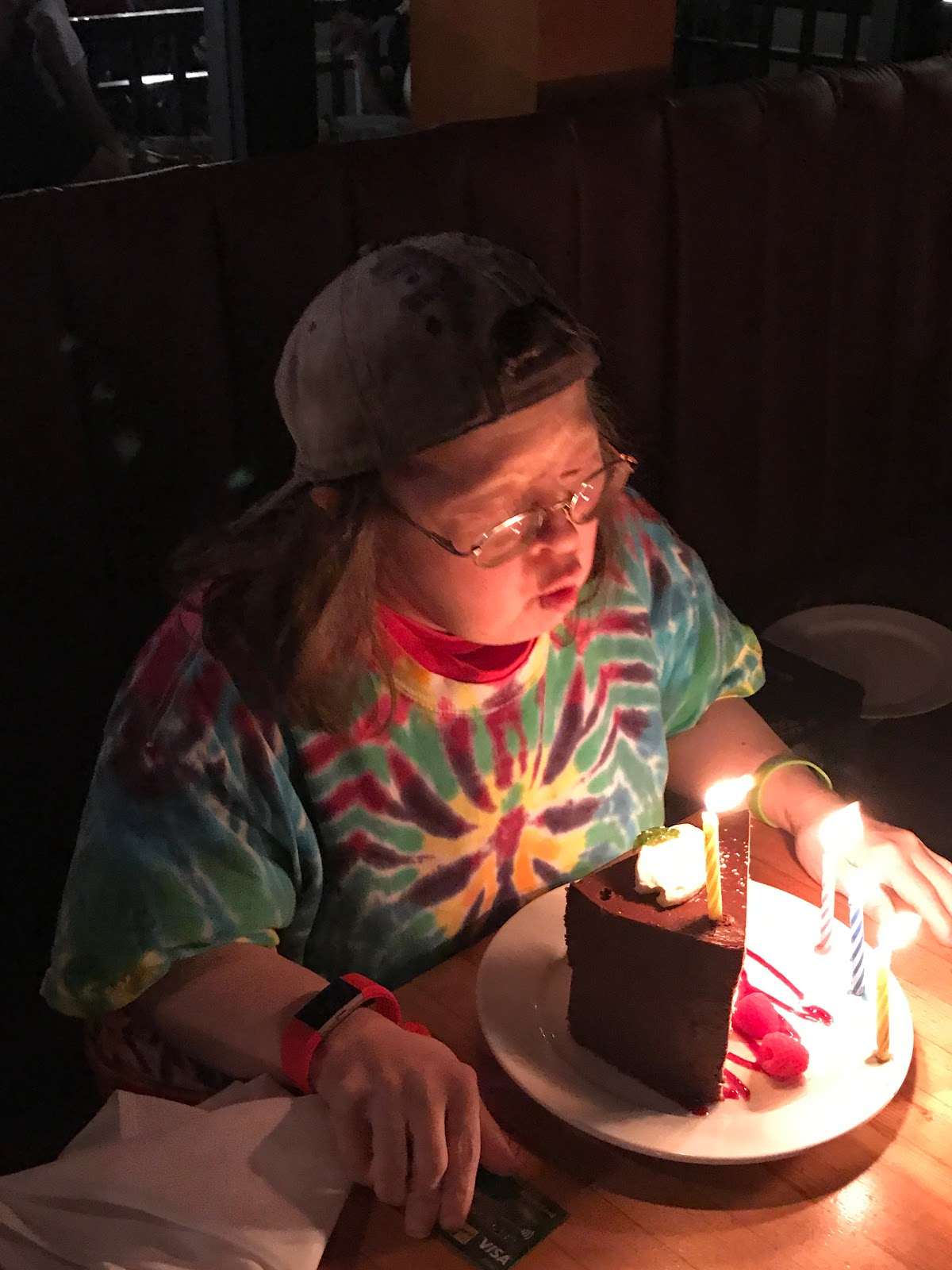Teresa blows out a candle on her birthday cake at the Flying Pig restaurant in Gastown. Photo: Franke James