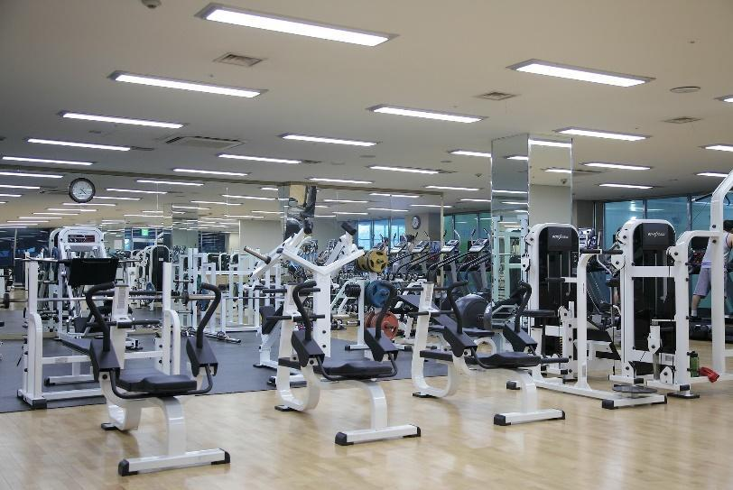 A gym lit up using L.E.D. lights.