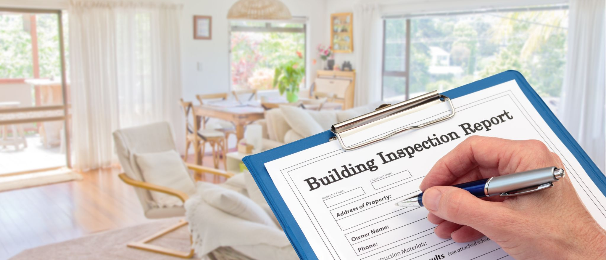 Structural engineer filling out a building inspection report.