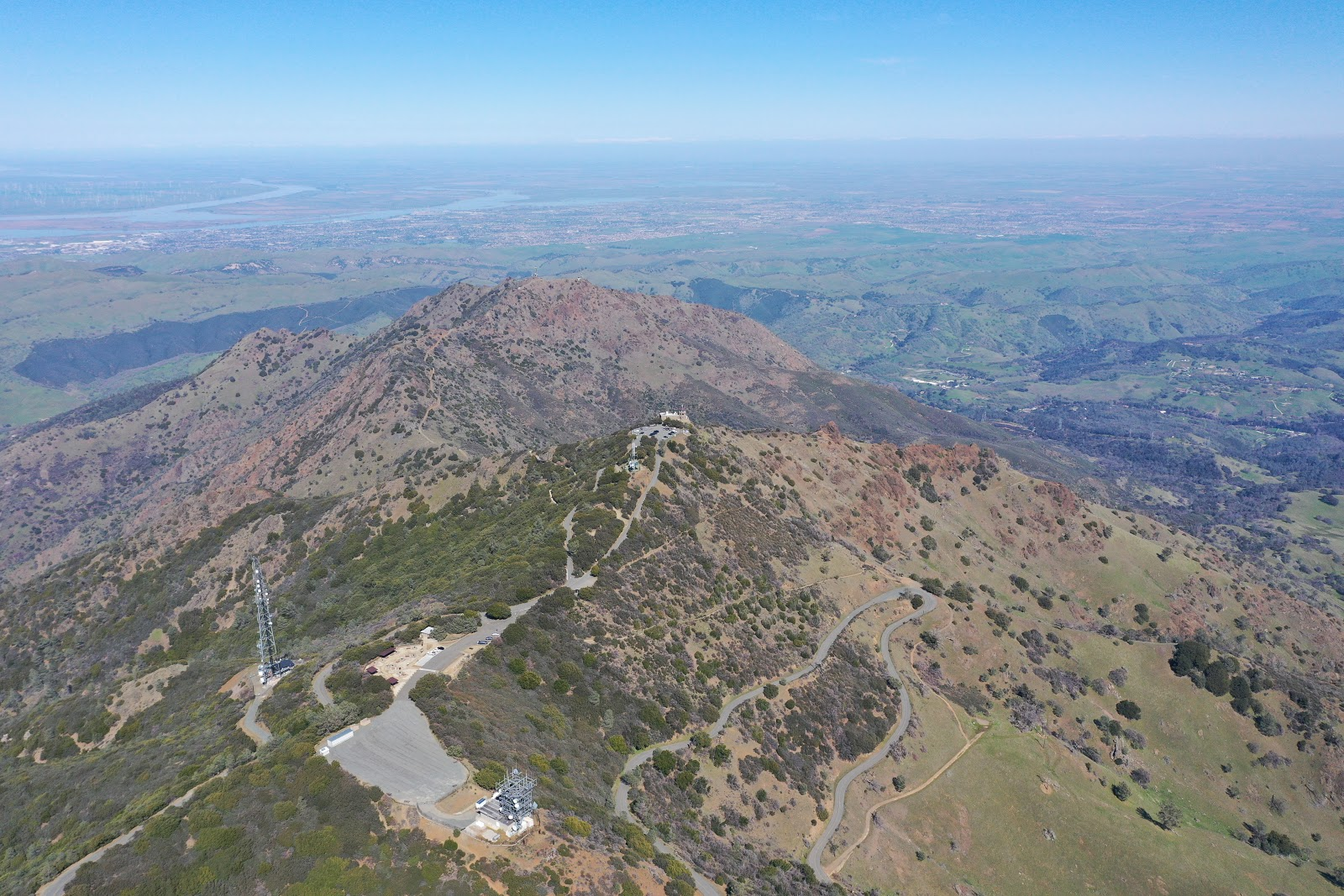 Cycling and riding by bike Mt. Diablo - aerial drone photo of Summit Road, visitor center, beacon and observation deck