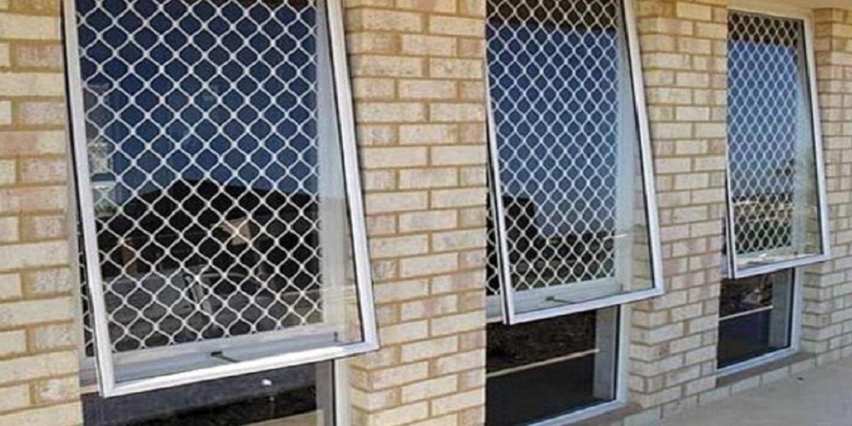 Uma imagem contendo edifício, tijolo, janela, fogo  Descrição gerada automaticamente