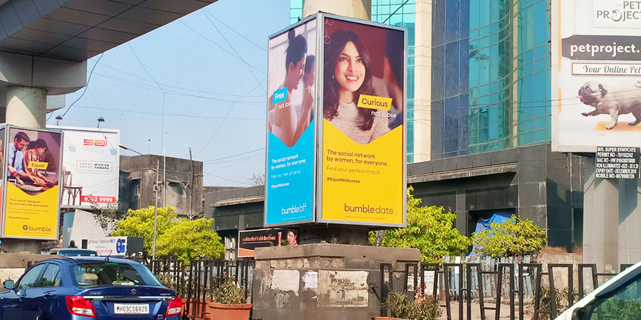 A Bumble billboard with Priyanka Chopra on the cover and the text 'The social network by women, for everyone'.