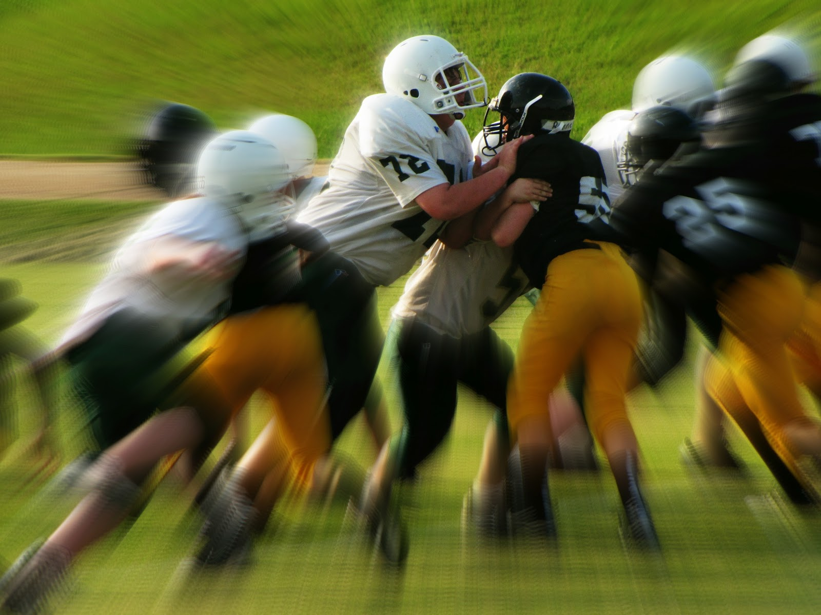 Men in White and Black Playing Football · Free Stock Photo