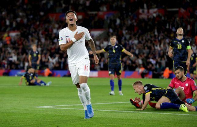 Jadon Sancho celebrates after scoring for England against Kosovo