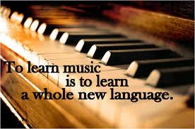 """piano with the quote """"To learn music is to learn a whole new language"""""""