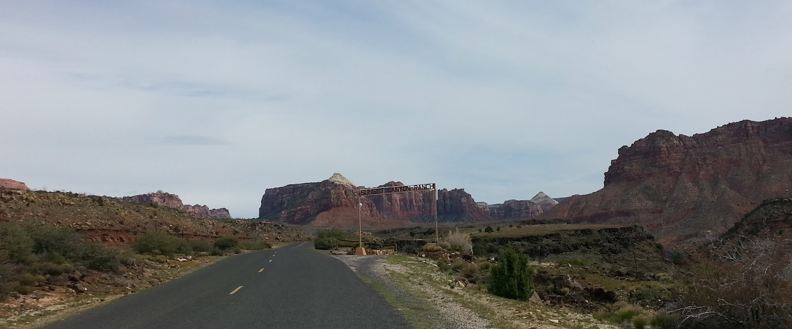 Bicycle ride up Kolob Terrace - red rock mountain formations and roadway