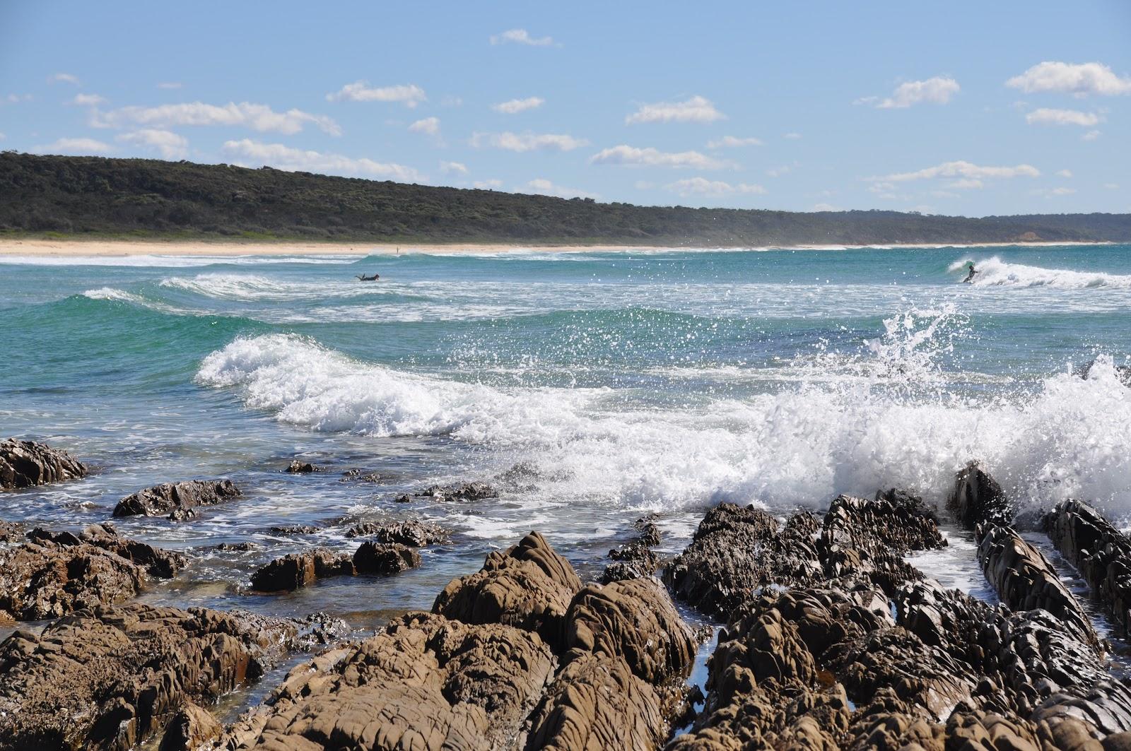 ocean waves hitting rocks narooma wagonga inlet australia beautiful beach
