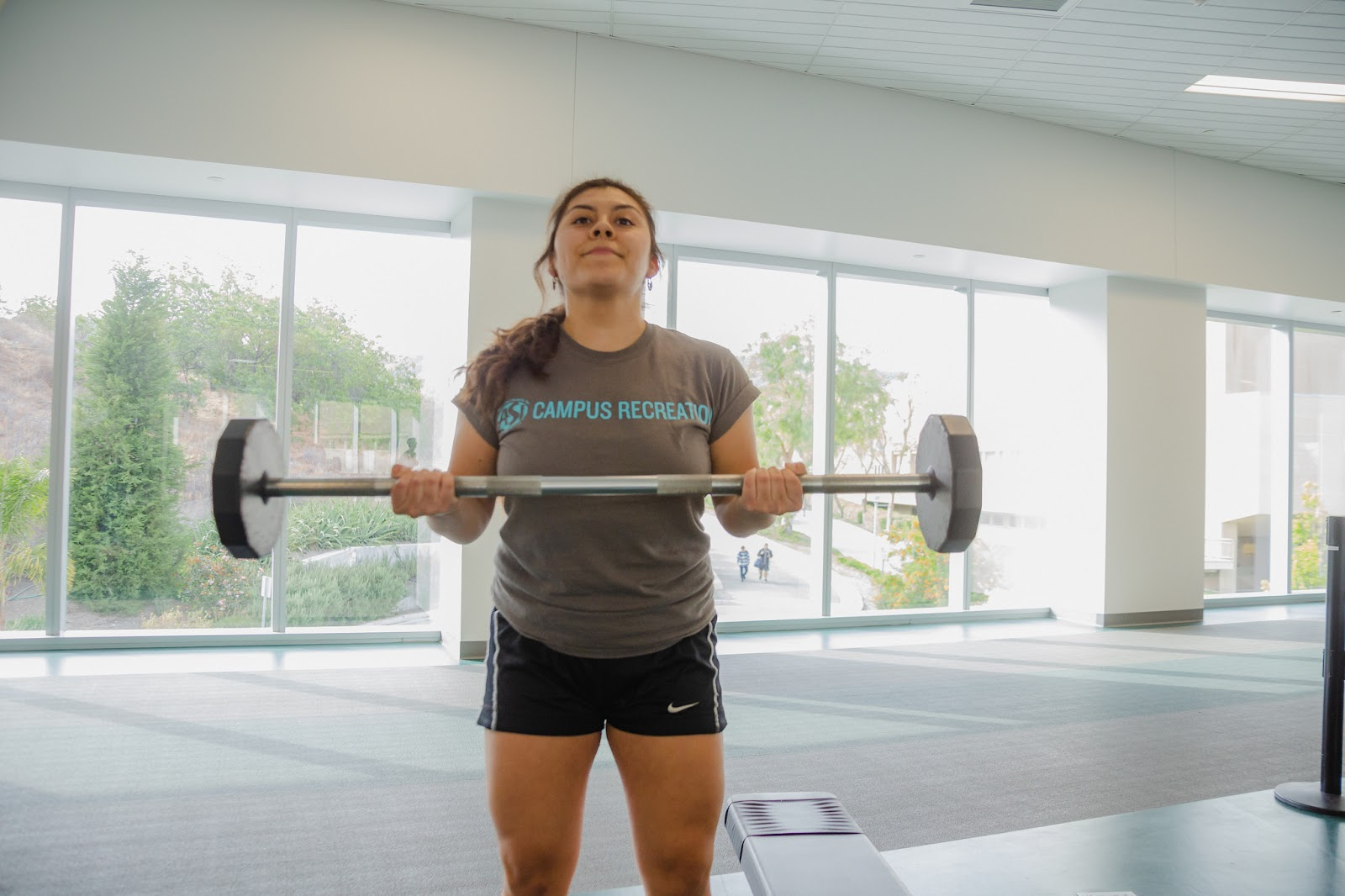 A focused Arellano Rodriguez lifting weights