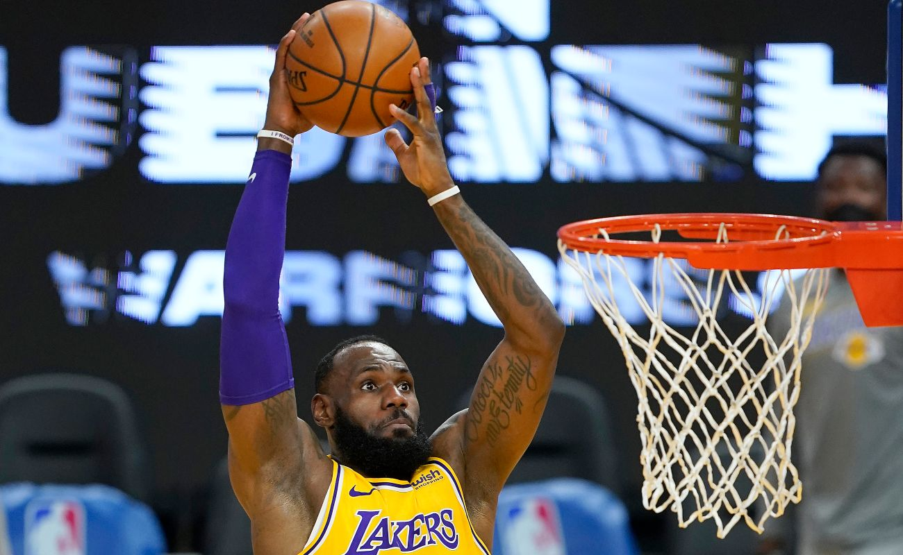 LeBron James #23 of the Los Angeles Lakers goes up for a slam dunk against the Golden State Warriors during the first half of an NBA basketball game at Chase Center on March 15, 2021 in San Francisco, California. (Photo by Thearon W. Henderson/Getty Images)