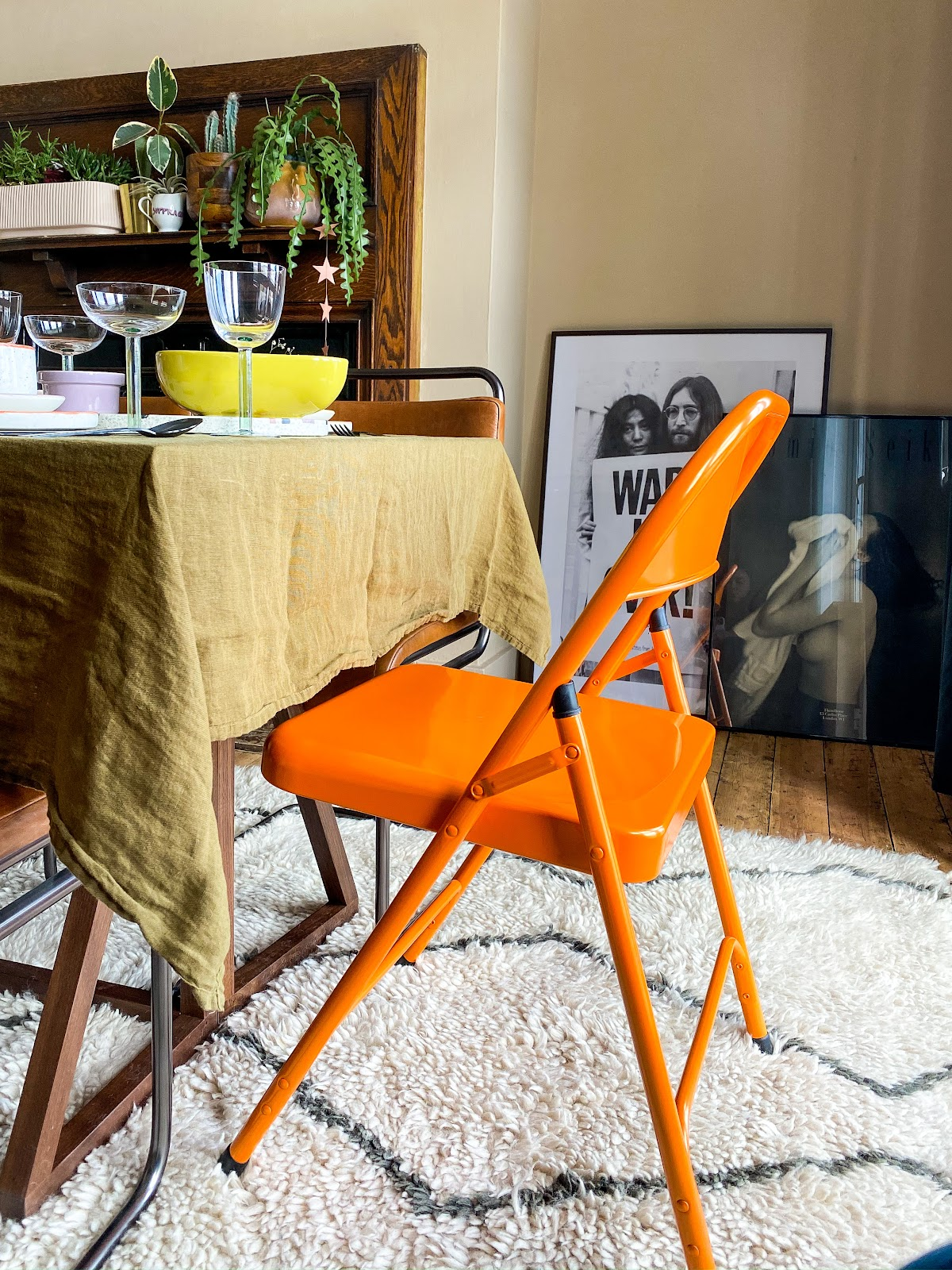orange folding metal chair at dining table