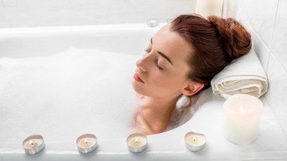 A woman relaxing in a bubble bath