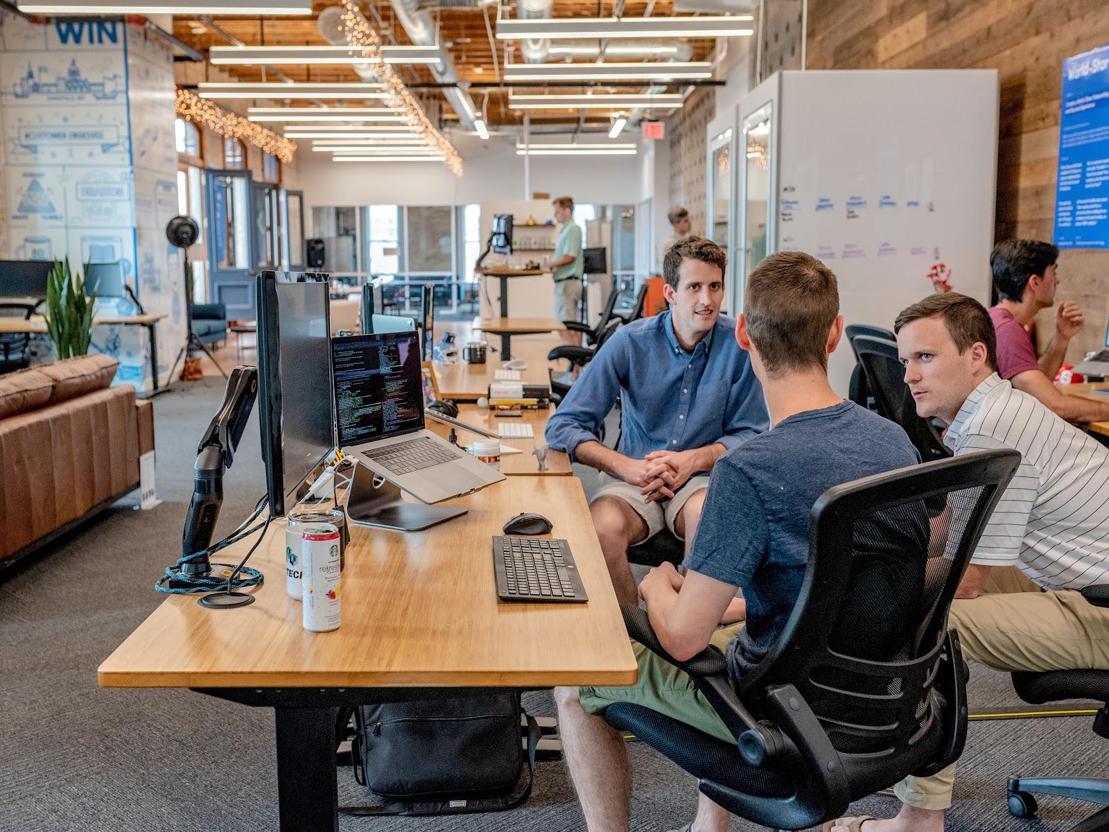 Startup employees talking