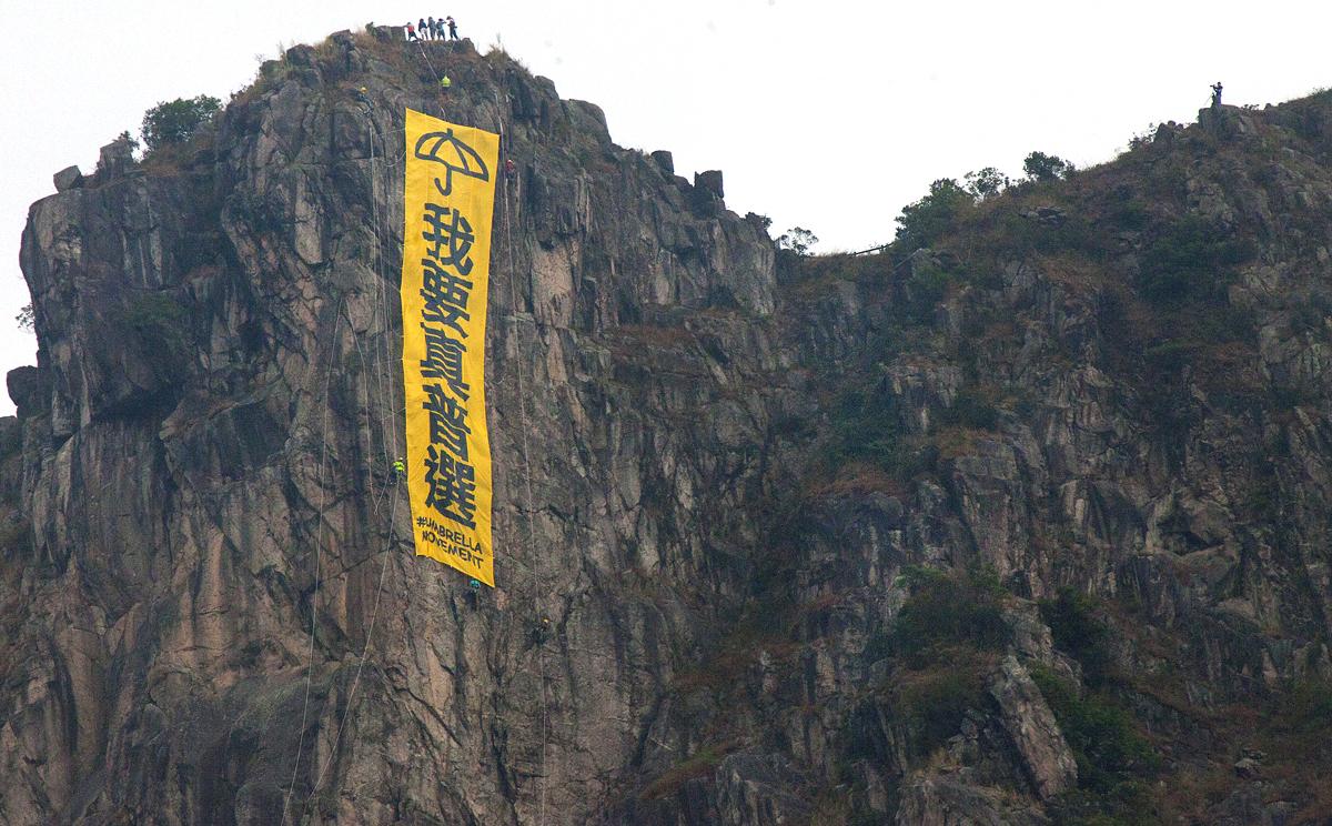 Pro-democracy banner hung from Lion Rock has officials scrambling | South  China Morning Post