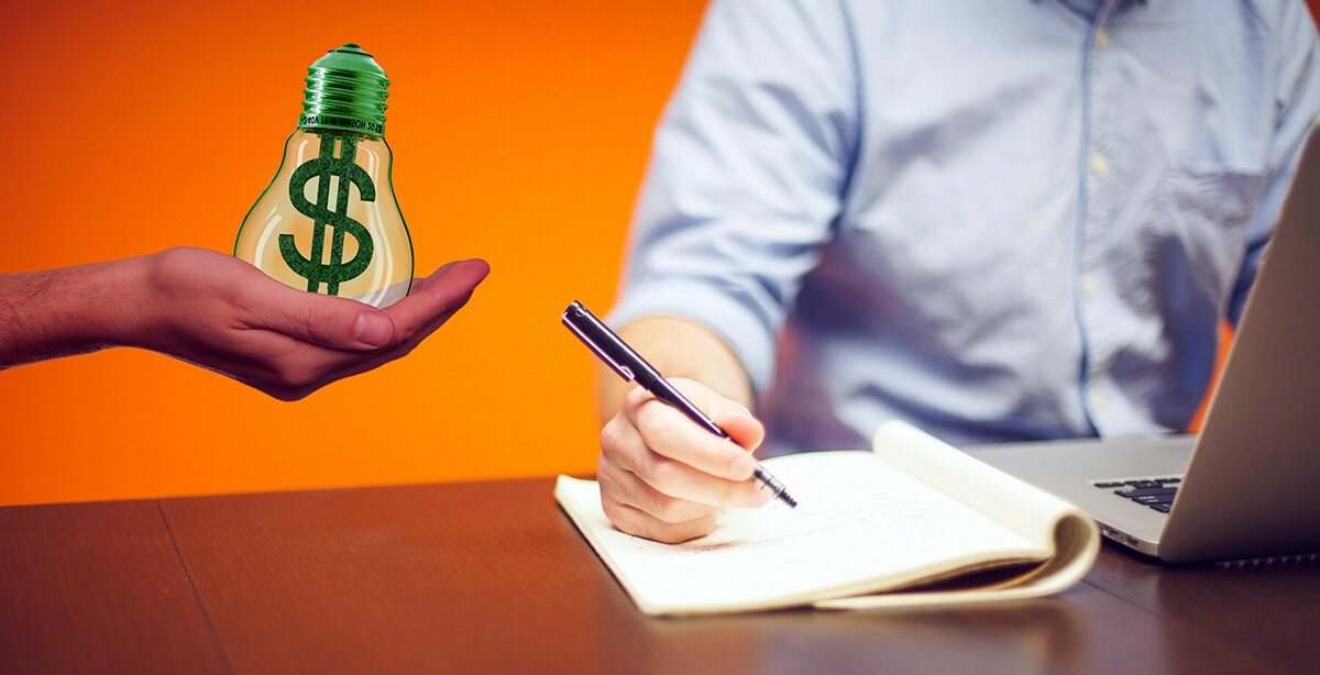 A man sits at a desk pondering monetization.