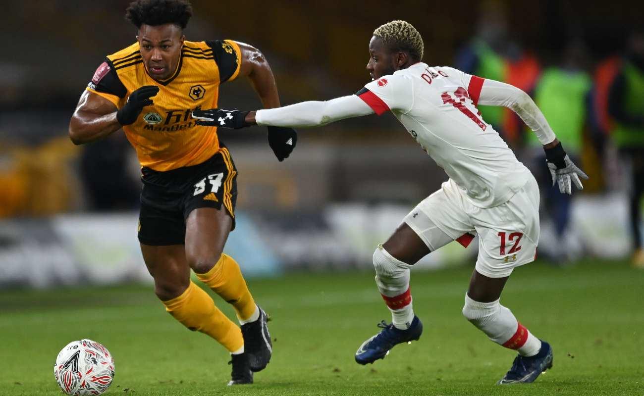 Wolverhampton Wanderers' Adama Traore vies with Southampton's Moussa Djenepo - Photo by SHAUN BOTTERILL/POOL/AFP via Getty Images