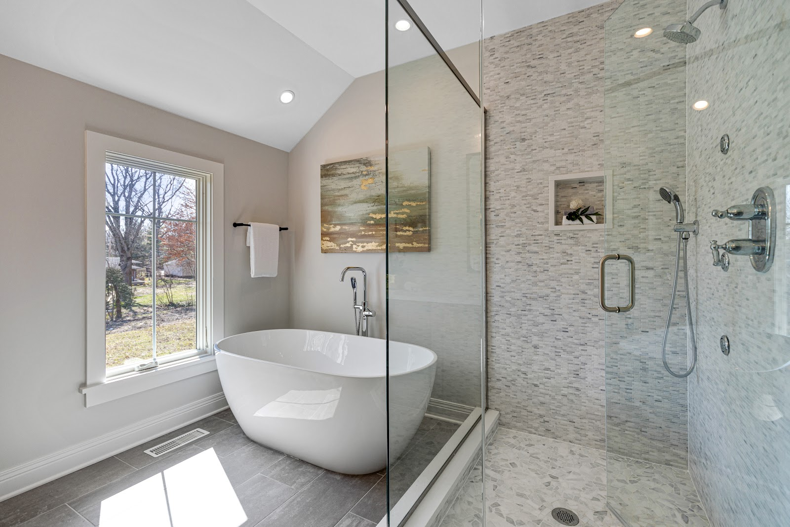 HDC bathroom with glass shower and ceramic tub