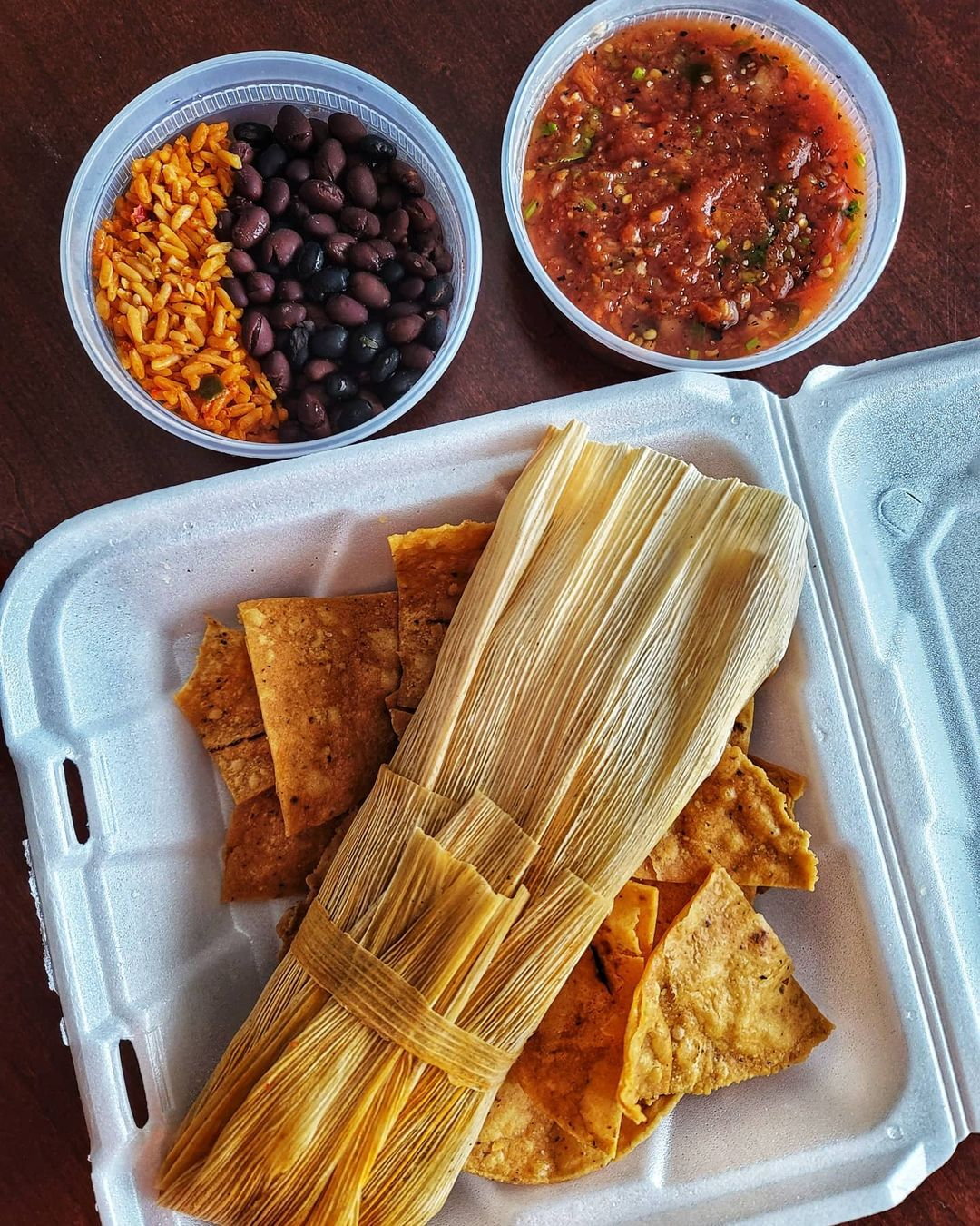 Hot and spicy pork tamale, rice, black beans, and salsa from The Tamale Place