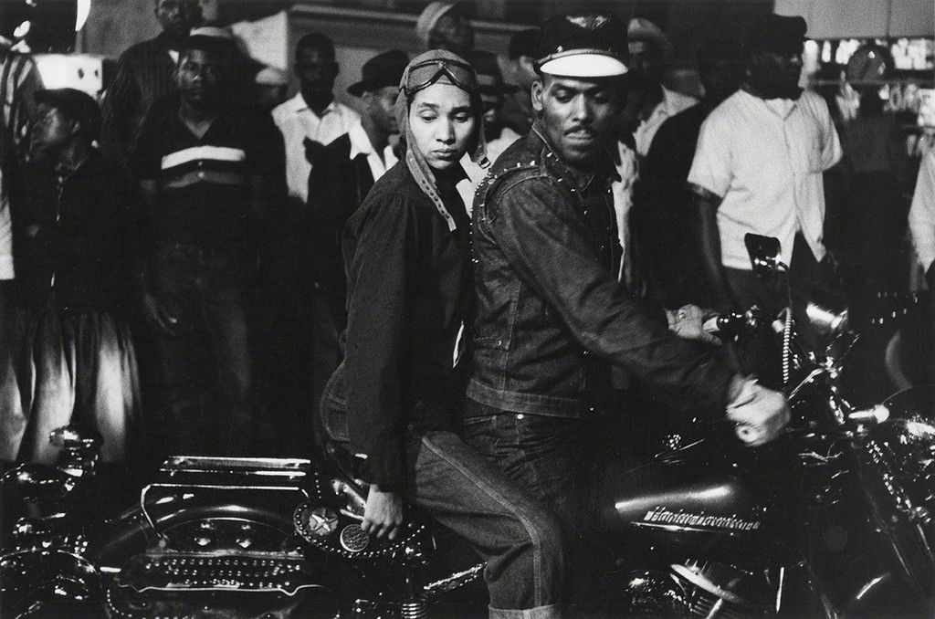 A black and white image of  a couple on a motorbike by famous photographer Robert Frank